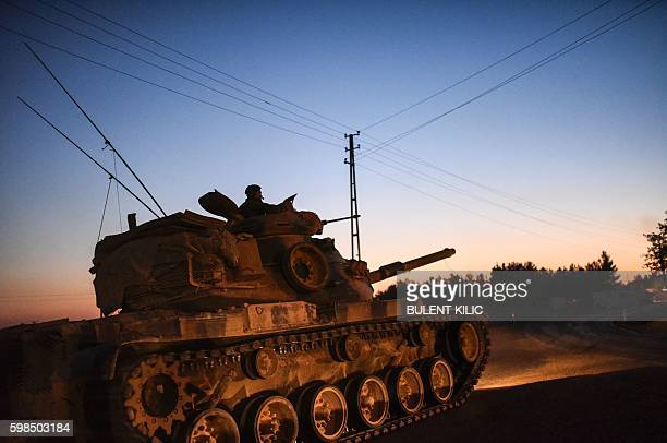 Turkish army tank is pictured driving back to Turkey from the SyrianTurkish border town of Jarabulus on September 1 2016 in the TurkishSyrian border...