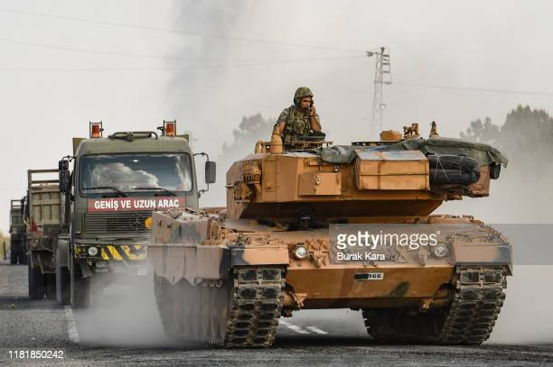 Turkish army tank moves towards the Syrian border on October 18 2019 in Ceylanpinar Turkey Turkish forces appeared to continue shelling targets in...