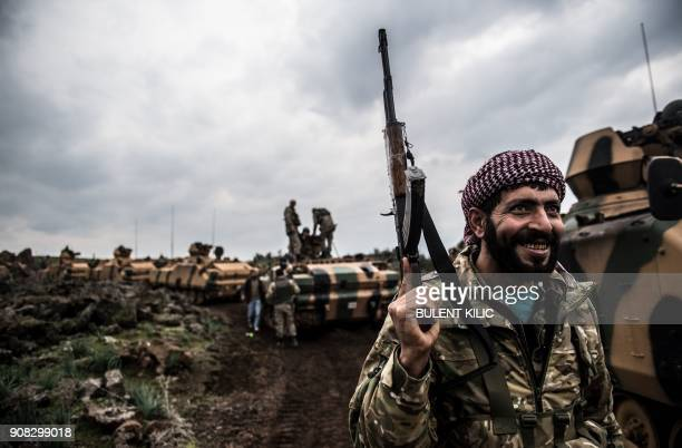 TOPSHOT Turkish army tanks and soldiers gather close to the Syrian border on January 21 2018 at Hassa in Hatay province Turkish forces on January 20...
