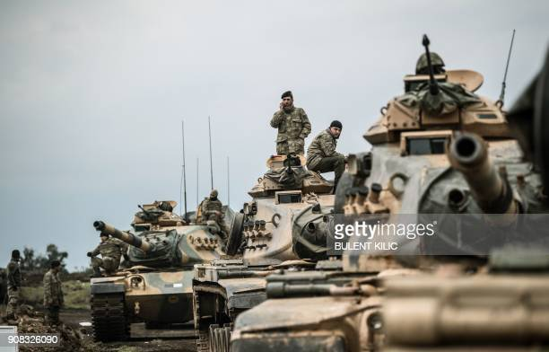 TOPSHOT Turkish army tanks gather close to the Syrian border on January 21 2018 at Hassa in Hatay province Turkish forces on January 20 began a major...