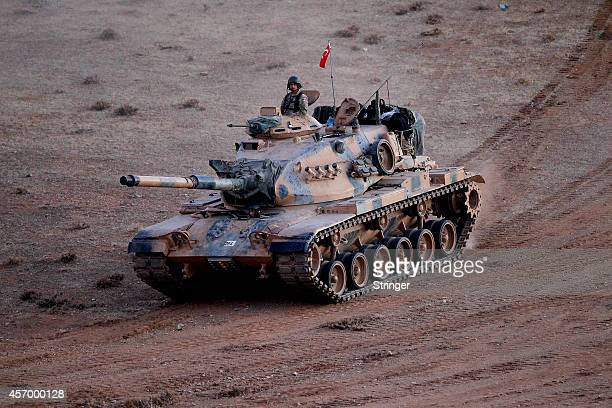 Turkish army tanks patrols in the southeastern town of Suruc close to the Mursitpinar border crossing on the TurkishSyrian border to Kobani October...