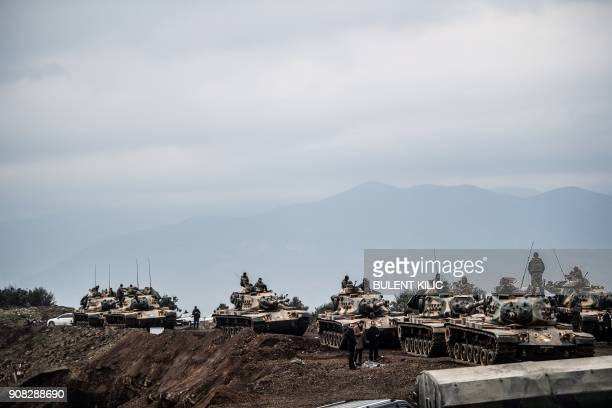 TOPSHOT Turkish army tanks wait near the border before entering Syria on January 21 2018 at Hassa in the Turkish province of Hatay near the Syrian...