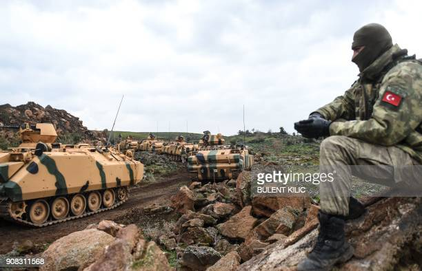 TOPSHOT Turkish army troops gather near the Syrian border at Hassa in Hatay province on January 21 2018 Turkish forces on January 20 began a major...