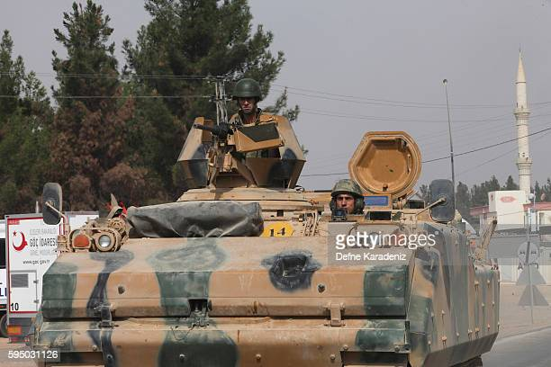 Turkish Army's armoured vehicles driving to the Syrian town of Jarabulus as they prepare for a military operation at the Syrian border town of...