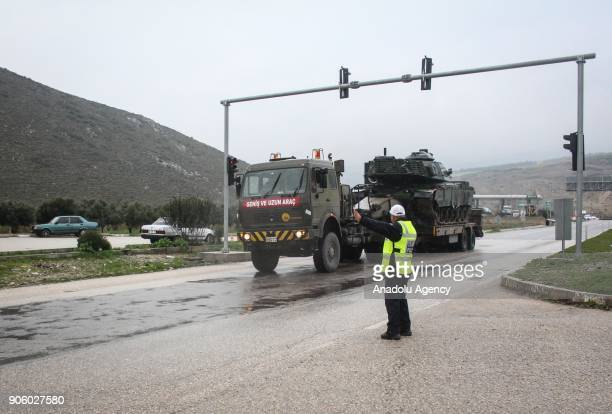 Turkish Army's military trucks carry armoured vehicles to reinforce the border units in Hatay Turkey on January 17 2018