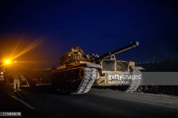 A Turkish army's tank drives towards the border with Syria near Akcakale in Sanliurfa province on October 8 2019 Turkey said on October 8 it was...