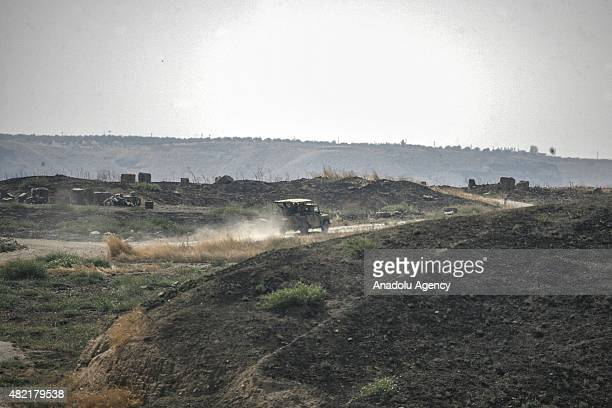 Turkish Army's tanks and artilleries stand guard as they are alerted in southeastern Turkey's border city Gaziantep's Karkamis District on July 28...