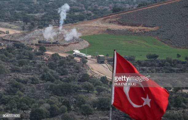 TOPSHOT Turkish artillerys shell the People's Protection Units positions near the Syrian border on January 21 2018 near Hassa in the Turkish province...