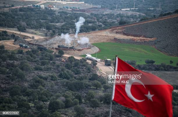 Turkish artillerys shell the People's Protection Units positions near the Syrian border on January 21 2018 near Hassa in the Turkish province of...
