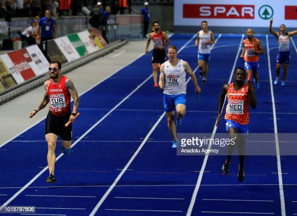 Turkish athlete Ramil Guliyev competes in men's 4x100m relay final during the 2018 European Athletics Championships in Berlin Germany on August 12...