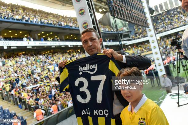 Turkish businessman and newly elected Fenerbahce chairman Ali Koc poses with a jersey to his name during a gathering at the Ulker Stadium in Istanbul...