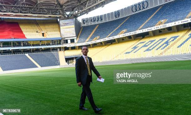 Turkish businessman and newly elected Fenerbahce chairman Ali Koc walks on the pitch during a gathering at the Ulker Stadium in Istanbul on June 5 in...