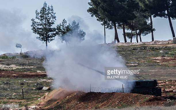 Turkish cannons fire from their army position near the Oncupinar crossing gate close to the town of Kilis south central Turkey towards the Syria...