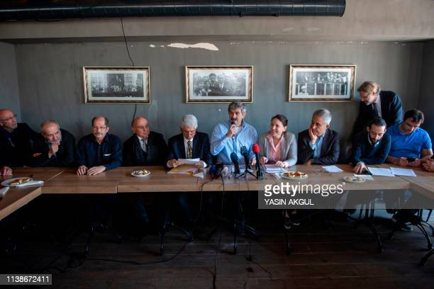 Turkish cartoonist Mustafa Kemal Gungor speaks during a press conference held by opposition journalists in Istanbul on April 22 2019 Opposition...