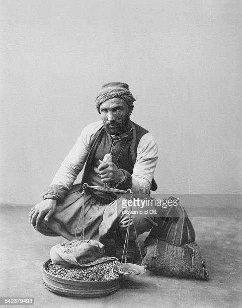 Turkish chickpeas trader with scales and produce