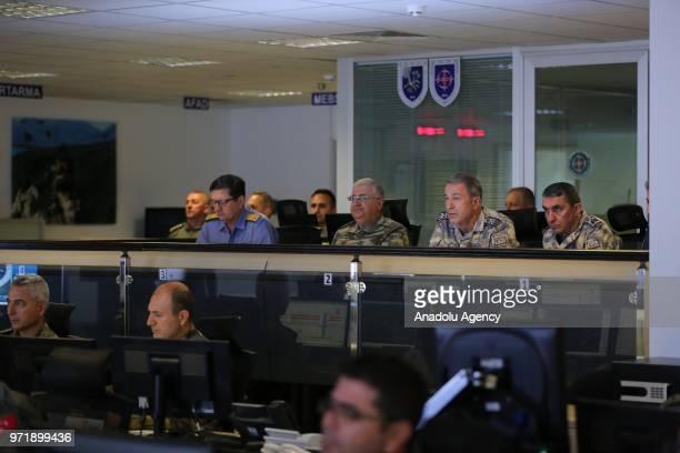 Turkish Chief of General Staff Hulusi Akar monitors the air operations towards Iraq's Qandil Sinjar Hakurk and AvasinBasyan regions at Combined Air...