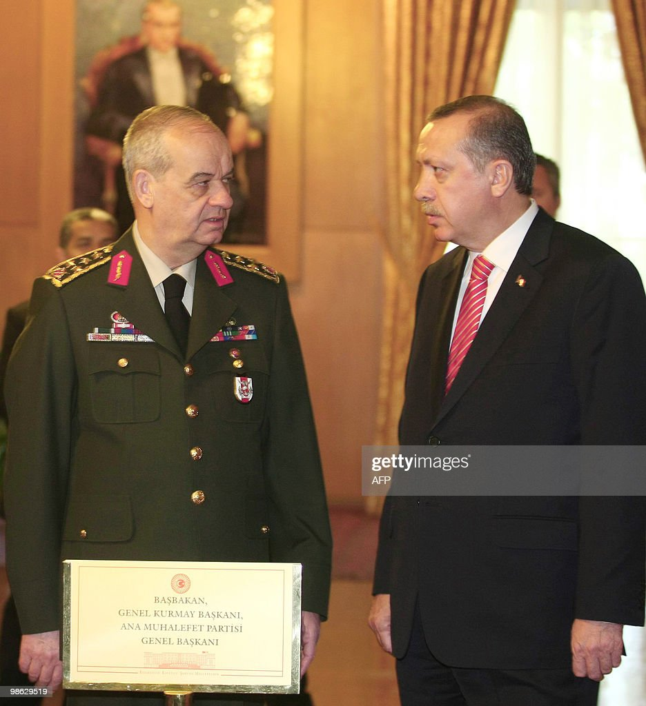 Turkish Chief of General Staff Ilker Basbug (L) and Turskish Prime Minister Recep Tayyip Erdogan (R) stand during a ceremony at parliament on April 23, 2010 in Ankara. Turkey is celebrating the 90th anniversary of the opening of the National Assembly.