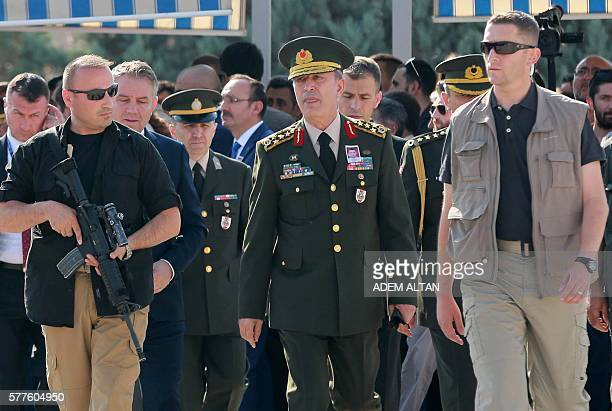 Turkish Chief of the General Staff Hulusi Akarar attends the funeral ceremony of special forces police officer Fevzi Basaran killed during the failed...