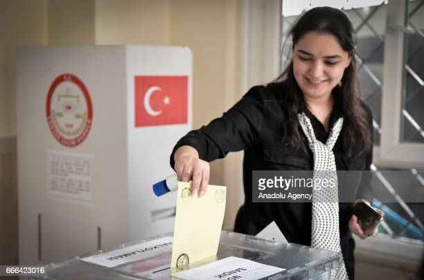 Turkish citizen casts her vote prior to Turkey's upcoming constitutional referendum at Turkish Embassy in Tehran Iran on April 9 2017 Turkey will...