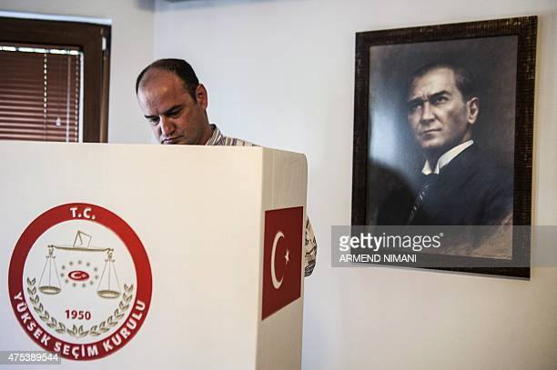 A Turkish citizen living in Kosovo casts his ballot for the upcoming Turkish general elections at the Turkish embassy in Pristina on May 31 2015 The...