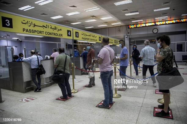Turkish citizens are seen at Khartoum International Airport ahead of a flight to Turkey as part of the evacuation process due to the coronavirus...
