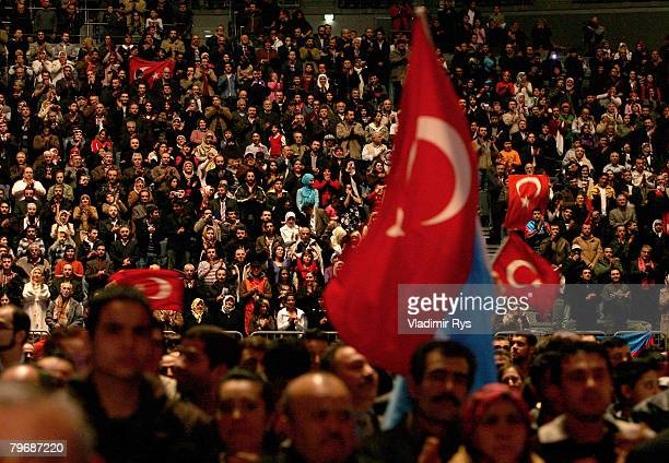Turkish citizens are seen in a sold out KoelnArena priro to the speach of the Turkish Prime Minister Recep Tayyip Erdogan on February 10 2008 in...