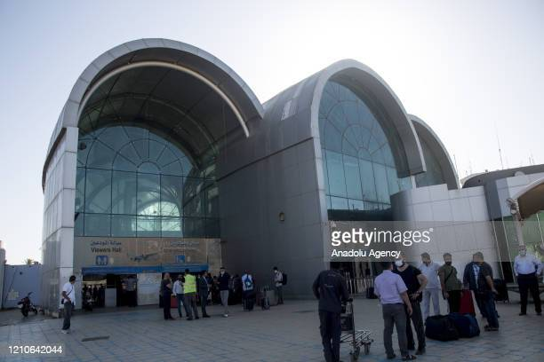 Turkish citizens arrive at Khartoum International Airport ahead of a flight to Turkey as part of the evacuation process due to the coronavirus...