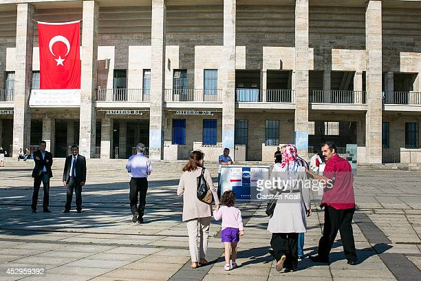 Turkish citizens arrive at the Olympiastadion stadium to vote in Turkish presidential elections on July 31 2014 in Berlin Germany Turkish Prime...