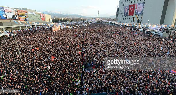 Turkish citizens listen as Prime Minister Recep Tayyip Erdogan speaks during a local election rally organized by the ruling Justice and Development...
