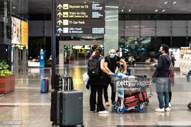 Turkish citizens wait at Changi Airport for the special flight of the Turkish Airlines, during their evacuation to Turkey amid the coronavirus...