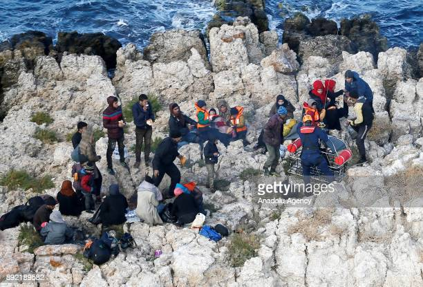 Turkish Coast Guard arrive to airlift refugees within a rescue operation for the refugees stuck in rocks in offshore Dikili district of Izmir Turkey...