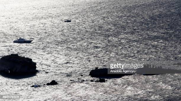 Turkish Coast Guard boat approaches rocky islet within a rescue operation for the refugees stuck in rocks in offshore Dikili district of Izmir Turkey...