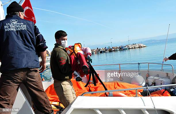 A Turkish coast guard carries the body of a child off a rescue boat on February 8 2016 at Altinoluk district in Balikesir At least 35 migrants...