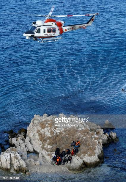 Turkish Coast Guard helicopters airlifts refugees within a rescue operation for the refugees stuck in rocks in offshore Dikili district of Izmir...