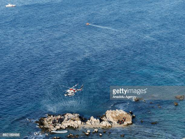 Turkish Coast Guard helicopters fly over the Aegean Sea within a rescue operation for the refugees stuck in rocks in offshore Dikili district of...