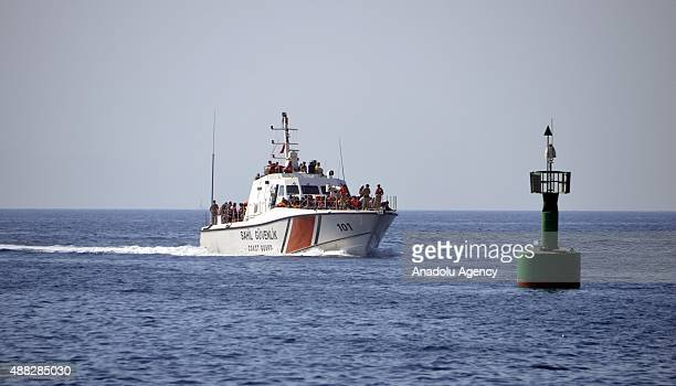 Turkish Coast Guard rescue refugees after a vessel with refugees on board sailing from the Bodrum coast to the nearby Greek island of Kos sank off...