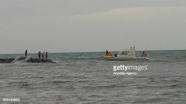 Turkish coast guards conduct a search and rescue operation as bodies of 8 refugees are washed ashore on a beach in Ayvalik district of Balikesir...