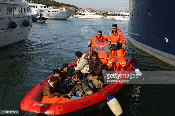 Turkish Coast Guards refugees captured by Turkish coast guard in the Aegean Sea are seen iCesme district of Izmir Turkey on April 1 2016 Turkish...