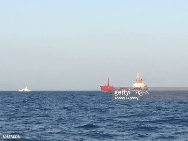 """Turkish Coastal Guard boat approaches to a Turkish commercial ship named """"ACT"""" on Aegean shores of western Turkey's Mugla province on July 03, 2017..."""