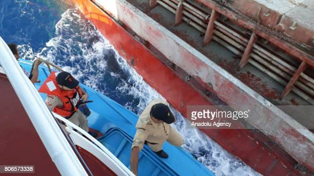 """Turkish Coastal soldiers leave a coastal guard boat to get in a Turkish commercial ship named """"ACT"""" as they arrived on Aegean shores of western..."""