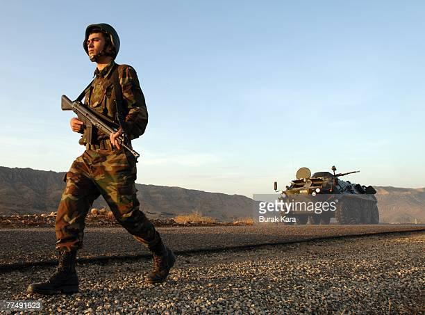 Turkish commandos and progovernment guards patrol the area near TurkeyIraq border October 25 2007 in the Kasrik province of Sirnak TurkeyThe buildup...