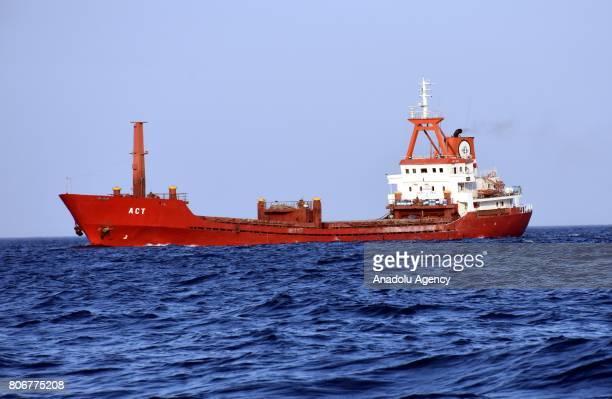 "Turkish commercial ship named ""ACT"" is seen on Aegean coast of western Turkey's Mugla province on July 03, 2017 as Turkish Coastal Guard boats escort..."