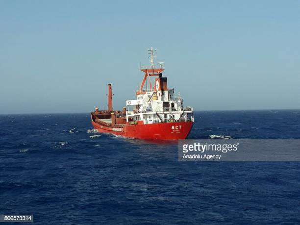 """Turkish commercial ship named """"ACT"""" is seen on Aegean shores of western Turkey's Mugla province on July 03, 2017 as Turkish Coastal Guard boats..."""