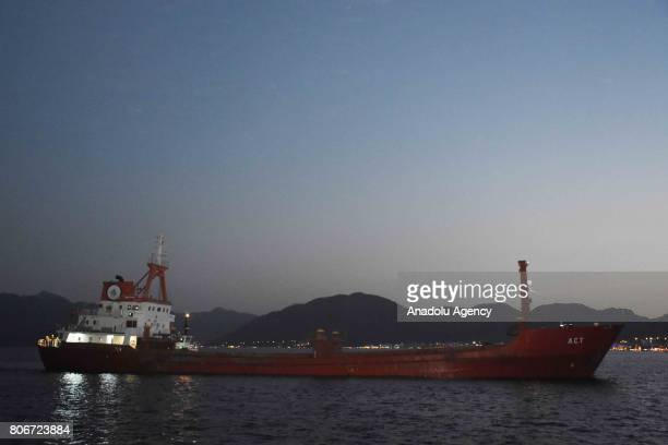 """Turkish commercial ship named """"ACT"""" is seen on Aegean shores of western Turkey's Mugla province on July 03, 2017. Greek coastal guard boats Monday..."""