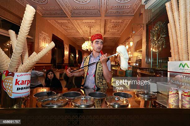 Turkish confectioner prepares an ice cream in the tradition way