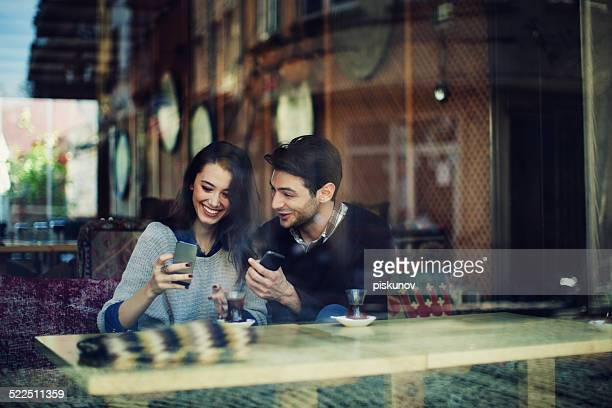 Turkish Couple in Cafe Use Smart Phones