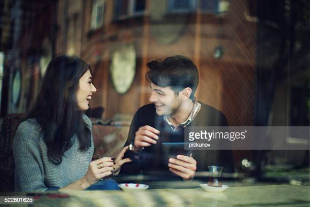 Turkish Couple in Cafe Use Tablet