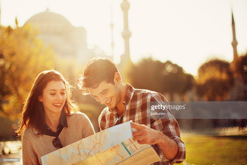 Turkish Couple Use Paper Map : Stock Photo