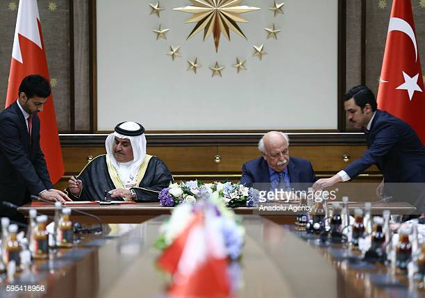 Turkish Culture and Tourism Minister Nabi Avci and Bahraini Shaikh Khalid bin Ahmed Al-Khalifa sign an agreement during an Inter-Committee Meeting at...