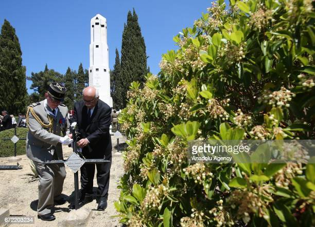 Turkish Culture and Tourism Minister Nabi Avci leaves flowers to the graves after the ceremony at French Memorial on Gallipoli Peninsula as part of...